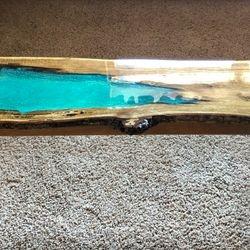 """Bench. Live Edge Oak with Okinawa blue resin. 65""""L X 16""""W X 16""""T."""