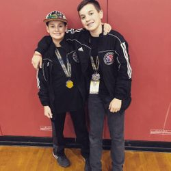 Sprit 1 Taekwondo brothers with their medals