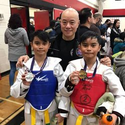 Master Michael Tam posing with two medalist at the Victory Cup Challenge
