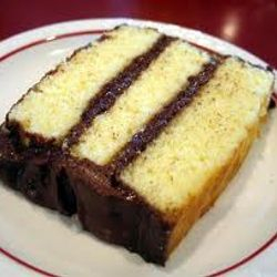 Old fashion yellow cake with chocolate frosting