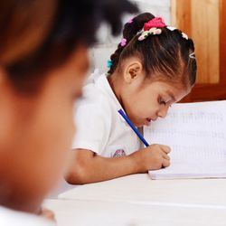 Children attend the Hope Academy to get help with school work.