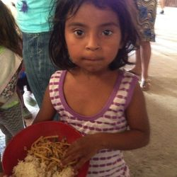 Little girl receives her meal