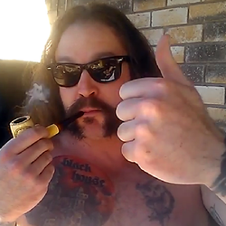 Clint smoking a Meerschaum pipe and vlogging. Shirts not required.
