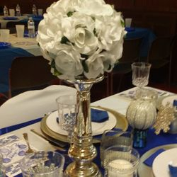 Main table setup with silver candlesticks and rose balls