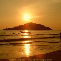 Watch a beautiful sunset in Goa.