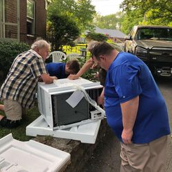 GoodWorks volunteers installing an AC unit for an elderly resident.