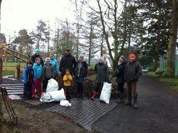 Adding mulch in the rain is a mucky job!