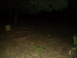 Small bright orb in cemetery