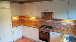 KITCHEN UPGRADED TO high gloss ivory slab doors and walnut block worktops pic 4 of 6