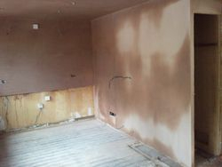 Kitchen removed and new wall built with door blocked off and plastered pic 3