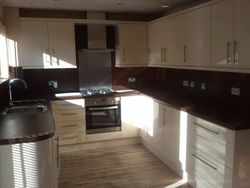 pic 6  kitchen upgraded to Magnet,  JUNO CREME LINEAIRE HIGH GLOSS CREAM