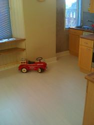 B&Q ivory laminate flooring laid in kitchen and diningroom areas.