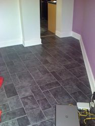 Tiled effect laminate flooring