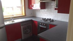 Kitchen worktops now replaced pic 3 of 4