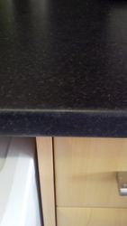 Dent in front of laminate worktop repaired pic 3