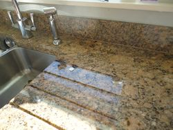Image of Granite worktop chip to be repaired pic 1 of 9