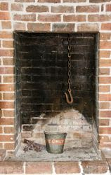 Fireplace with bucket and hook