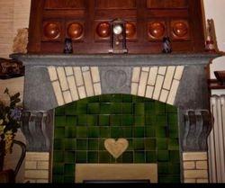 Cheminée Maison Piot On retrouve le motif coeur et les boules