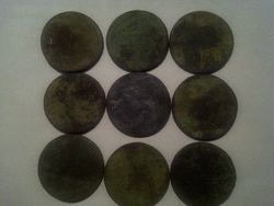 9 worn weathered coins