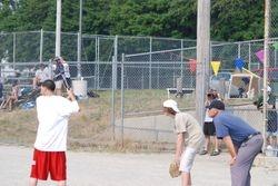 Dustin at bat, Lil' Dustin catching, Ed umping