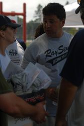 Winning team captian Al Borges handing out prizes