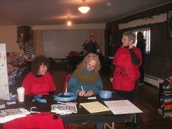 Margaret, Linda & Carole get the raffles ready
