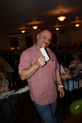 Winner of door prize; Mark shows off his tickets