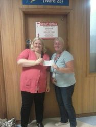SHAZ HANDING OVER THE CHEQUE FOR FUNDS RAISED