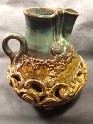 Double walled carved pitcher