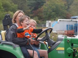 Excited kids on a tractor ride