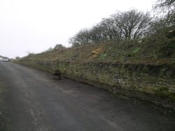 A view of the retaining wall along by the road.