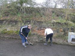 A couple of volunteers at work.