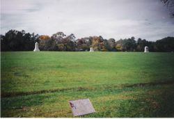 Confederate matkers in the foreground, and Union monuments in the distance at Chickamauga
