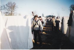 Dan Bortolin, standing in front of his tent at Spring Hill
