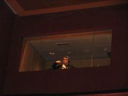 Darren Meng interpreting in Plenery Hall's dedicated Interpreter's Room