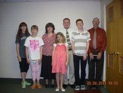 Pastor Steven Parker (on right)-Pastor's daughters on left