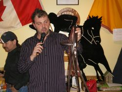 Dancin' Dan auctioning off a bridle