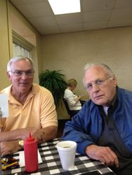 Bill Gipson and Dick Wright having the best hamburgers at Skyline Cafe