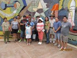 ELCA Members on boat tour.5 against the mural