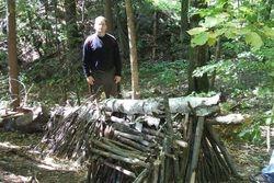 Debris hut partially built.
