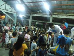 Pastor Jonathan distributes clothing to the children