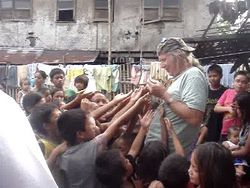 Tom handing out numbers to receive food in Mindanao