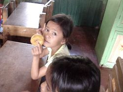 a student eats some pastry