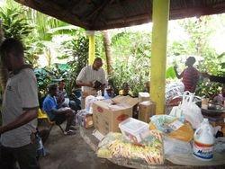 Pastor Quirico unpacking the supplies