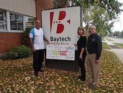Cheque presentation at Baytech Plastics