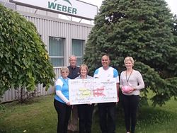 Cheque presentation at Weber Manufacturing