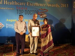 """Dr. Jyotsna Gupta receiving award for """"BEST OBSTETRICIAN AND GYNAECOLOGIST IN DELHI"""""""