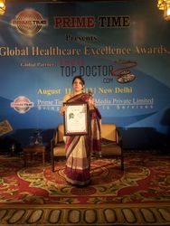 Dr. Jyotsna Gupta with the Trophy and Certificate