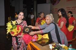 Dr. Jyotsna Gupta being presented with the prestigious award