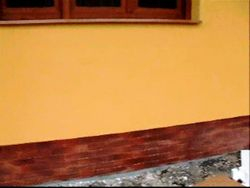 Montat caramida aparenta antichizata pe soclu casa,placat gresie alee treapta